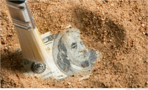 Paintbrush digging up a one hundred dollar bill